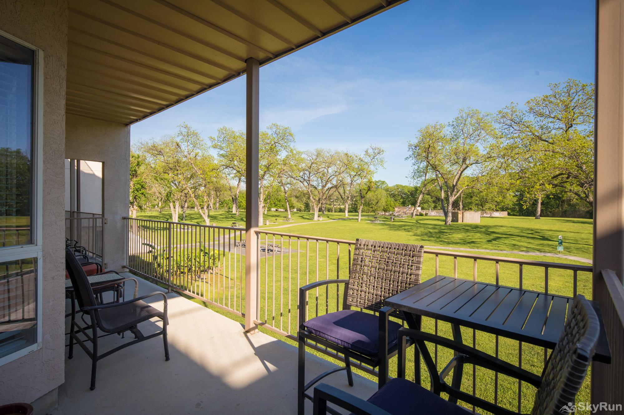 WATERWHEEL ESCAPE CONDO Patio with Great Views of the Huge Shared Lawn Space