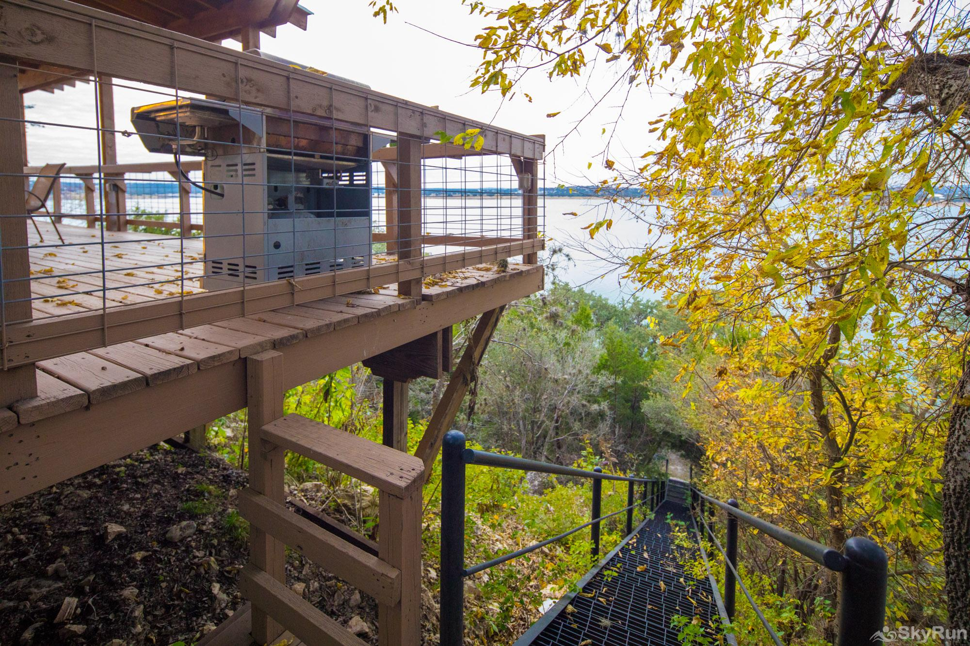 WATER'S EDGE RETREAT Staircase in backyard leading to Canyon Lake