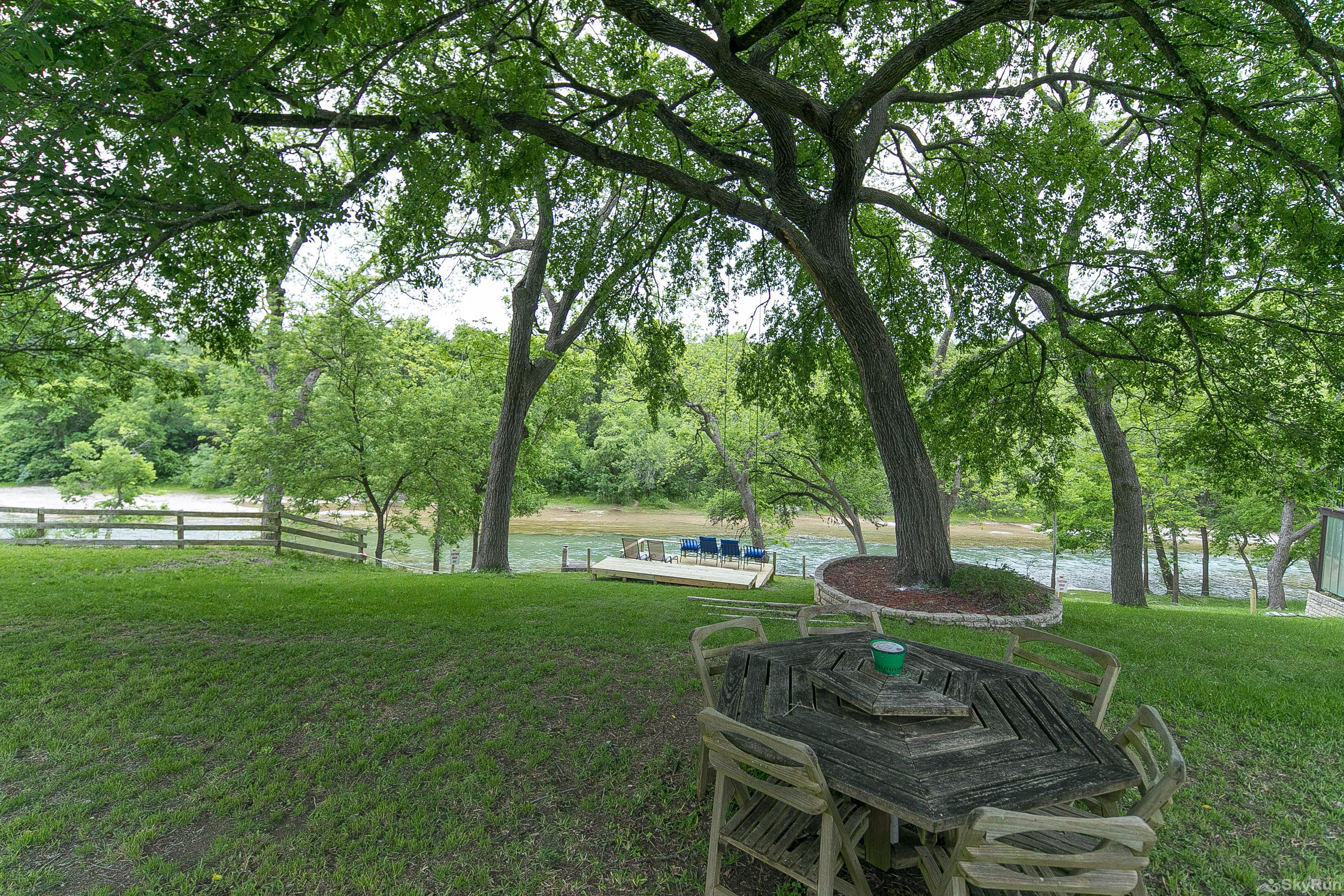RIVER ROSE Additional outdoor dining under the large shade trees